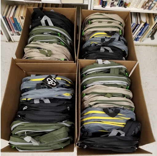 BP 2019 Boxes and boxes of backpacks were stuffed 152 backpacks in all